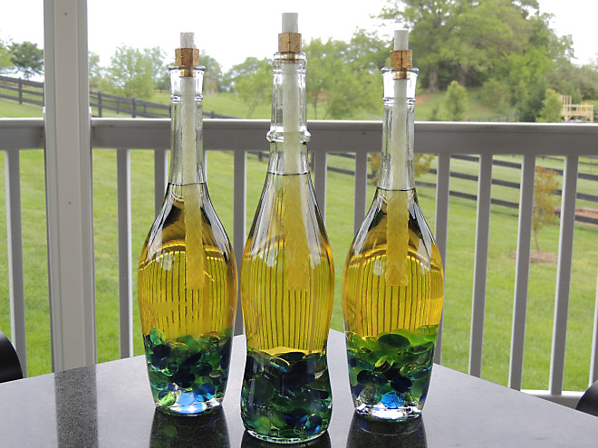 Wine Bottle Tiki Torches from The Armchair Sommelier Blog.